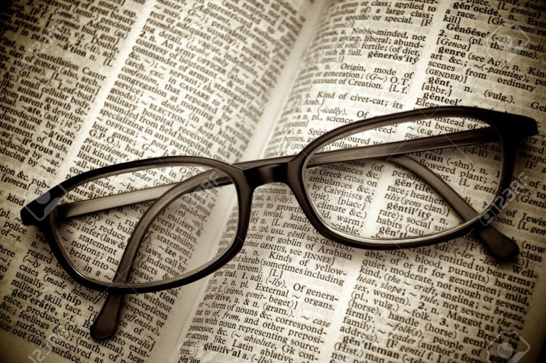 10232322-book-and-glasses-vintage-style-stock-photo-dictionary